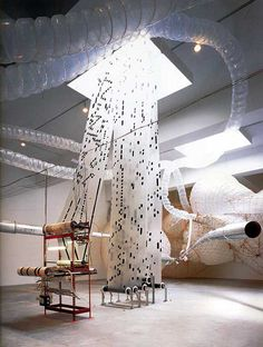 """Tim Hawkinson. """"Überorgan,"""" 2000. Woven polyethylene, nylon, net, cardboard tubing, various mechanical components, dimensions variable. Installation view at Ace Gallery, New York, 2002. Collection of Ace Gallery. Courtesy Ace Gallery, Los Angeles."""