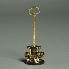 Timothy Langston - A 19th Century Rococo Style Brass Doorstop