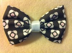 Video game hair bows by Crashedhope Designs- Portal Companion Cube Fabric Hair Bow $6.50, via Etsy.