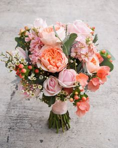 David Austin roses, berries, wax sprays and a touch of bougainvillea | floralmagic sg