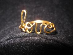 Gold Love Ring Wire Wrapped by aLilJazzJewelry on Etsy, $13.00