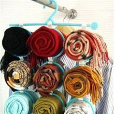 I use this for my scarves already (from IKEA) but this has them rolled up so neatly!