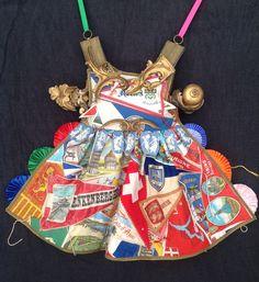 Karin van der Linden ~ Dress made of vintage souvenir flags | via artist's board: pinterest.com/sierlinde/assemblages/