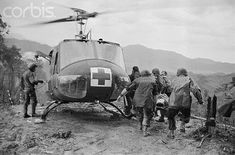 "18 May 1969, A Shau Valley, South Vietnam --- Paramedics load wounded paratroopers of the 101st Airborne Division into a UH-1 Iroquois, also known as a ""Huey,"" following fierce fighting on ""Hamburger Hill"" in South Vietnam's A Shau Valley. The hill was taken after the 10-day 11-assault campaign which left more than 300 US soldiers killed or wounded."