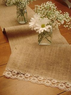 love the lace at the end of the burlap, then add sunflowers to the center piece with the baby breath.. perfect for table runners at reception.