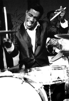 "He COULD really play - but not really ""his job"" // Sammy Davis Jr. - in addition to singing, dancing and acting, Sammy was not a bad drummer. He was also a ""quick draw"" specialist! So many talents - MReno I Movie, Movie Stars, Black Music Artists, Sammy Davis Jr, Vintage Black Glamour, Singing Career, Jazz Musicians, Drum Kits, My Black Is Beautiful"