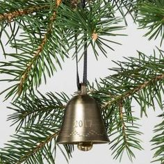 """You'll always be able to look back on the joy of the 2017 holiday season when you add the Vintage Bell Ornament 2017 from Hearth & Hand™ with Magnolia to your collection of Christmas ornaments. This simple ornament consists of a gold-tone brass bell with """"2017"""" engraved into it, and a plain black ribbon looped through the top for easy hanging. You'll love how well this ornament complements both classic and contemporary ornaments, and the way the metal catches th..."""