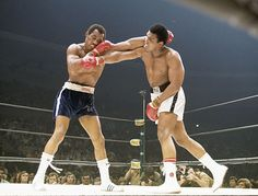 Muhammad Ali and Ken Norton exchange blows during their 1973 fight in San Diego, the first of their three bouts against one another. Ali would wind up losing a 12-round decision after Norton broke his jaw early in the fight. #boxing #sport