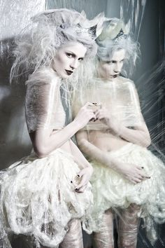 Ice Princess in cellophane reflecting envy on her mirror image.