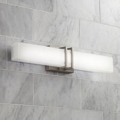 Wonderful Silkscreened Glass Creates A Soft Glow From This Stylish Modern LED  Bathroom Fixture.