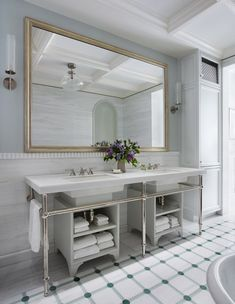 In the master bath, the texture of a fluted-marble detail creates contrast against seamless wall niches and inlaid-tile flooring highlighted by semiprecious stone. Dream Bathrooms, Beautiful Bathrooms, New York Townhouse, Nyc Brownstone, Diy Bathroom Remodel, Bathroom Ideas, Bathroom Vanities, Country Style Homes, Bath Design