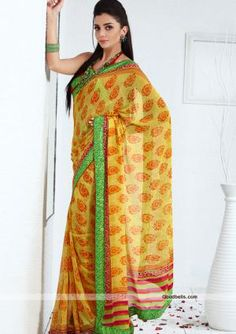 Get a designer look wearing this beautiful yellow shade saree decorated with designer prints. Multicolor pallu and contrast border gives it trendy look. It will look good for kitty as well as semi-formal parties. $35.00 http://goodbells.com/saree/printed-yellow-saree-with-contrast-border.html