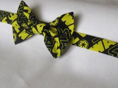 Yellow and Black Star Wars Bow Tie by PillowTalkbyShanna on Etsy, $12.99