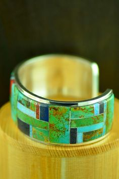 High Quality Navajo Sterling Silver Turquoise, Lapis, Spiny Oyster Shell, Lab Opal, Sugilite, Gold Lip Mother of Pearl and Jet Inlaid Bracelet by Lucy Cayatineto