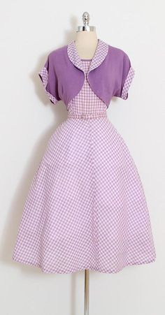 ➳ vintage 1950s dress and bolero  * lilac purple and white gingham * lilac linen * metal side zipper * original belt * right hip pocket  condition | excellent  fits like xl  length 46 bodice 17 bust 42 waist 32 hips up to 48  some clothes may be clipped on dress form to show best fit for appropriate size.  ➳ shop http://www.etsy.com/shop/millstreetvintage?ref=si_shop  ➳ shop policies http://www.etsy.com/shop/millstreetvintage/policy  twitter ...