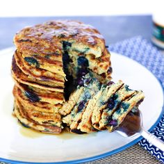 Gluten Free Vegan Protein Pancakes are a healthier no refined flour stack of pancakes! Packed with 7grams of fiber and 30grams of protein per serving!