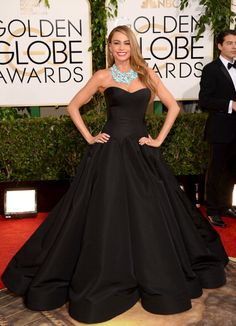 Sofia Vergara adds a pop of color to her Zac Pozen black gown with a teal bauble necklace.