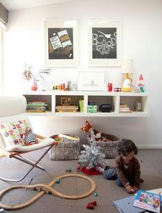 Playroom - Shelf under fireplace