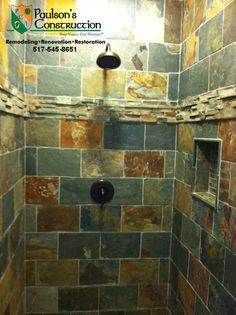 Slate shower with tiled niche & oil rubbed bronze fixtures.