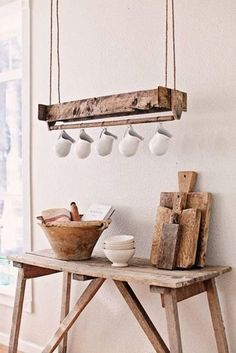 This clever and decorative cup holder is made from recycled wood, suspended from the ceiling by a single double string; pitchers are held with hooks. | Tiny Homes