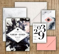 The beauty of these stone-inspired invitations is in the balance. The bold marbled background is softened with pretty pops of pale pink./