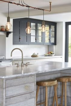 Blakes London.Love the dark cabinets with the pale 'driftwood'