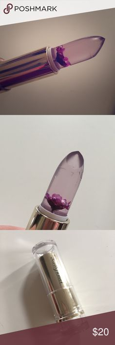 New Kailijumei jelly flower lipstick New never used Kailijumei jelly flower lipstick, transparent purple with real flower. Ordered two of these and like the other shade better so selling this one  never used, only swatched. #lipstick #kailijumei #jellylipstick #clear #flowerlipstick #makeup #cute #pretty #clear #asianmakeup #flowery #purple #jellyflowerlipstick Kailijumei Makeup Lip Balm & Gloss