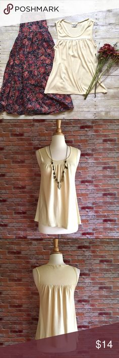 """Michael Stars golden cream tank Golden cream colored tank with scoop neck and a ruched bustline. Layer with jeans and your favorite cardigan or throw on with a maxi skirt (like the one shown, also for sale in my closet!). In good preloved condition, light wash wear. 50/50 cotton, nylon. Fits like a medium. 26""""L. 17"""" bust laying flat and unstretched. Michael Stars Tops Tank Tops"""