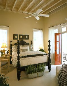 Coastal Living Cottage of the Year bedroom...love the black four poster bed and khaki walls
