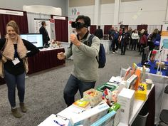 A visitor to our booth trying out the Virtual Reality headset Virtual Reality Headset, Desk, Home Decor, Homemade Home Decor, Desktop, Writing Desk, Office Desk, Offices, Decoration Home