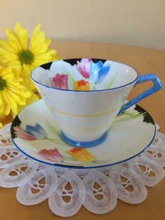 Paragon Teacup and Saucer, Art Deco Style, White and Blue with Hand Painted Tulips, Bone China – c. 1929-1933 by ToZoTeacups on Etsy https://www.etsy.com/listing/507052635/paragon-teacup-and-saucer-art-deco-style
