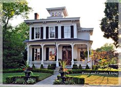 The Classic White House - Town & Country Living...Something about this house is absolutely mesmerizing. Not usually my style but makes me want to be a southern bell! <3