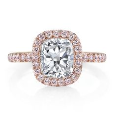EVA ROSE PINK is a handcrafted engagement ring set in 18K Rose Gold and shown with a Cushion cut diamond inside a seamless halo™ of rare, natural, Fancy, Argyle Pink Diamonds that are imported from the premiere Argyle Diamond Mine in Western Australia. #CushionCut #CushionDiamond #PinkDiamonds #EngagementRing #RoseGold #seamlesshalo #jeandousset