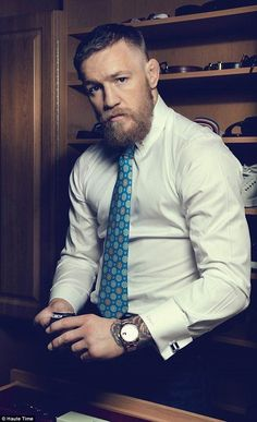 In the closet: Conor showing off the watch drawer in his massive walk-in wardrobe