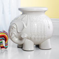 Ellie Side Table | Serena & Lily >> Not sure why but I have always wanted an elephant side table!