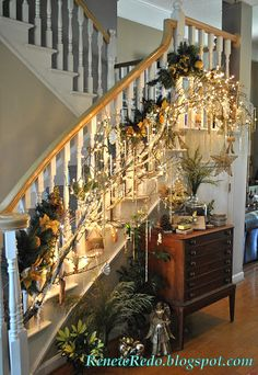 For the stairs,  I attached branches strung with white lights, to the spindels, then drenched them in lots of gold ornaments and bead strand...