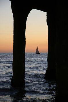 Sailboat through  Pier, Manhattan Beach, California via flickr