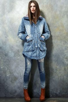 This padded coat has been crafted in cotton, featuring a zipped closure to front with hooded detail, long sleeves with quilted style, a faded vintage-style wash, in long length cut, in loose fit.$106.5