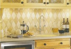 Tumbled natural stone brings  texture and warmth to a backsplash.