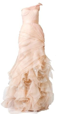 Farrah by Vera Wang  The Farrah is lavish with its frothy skirts full of blossoms and blooms. The tulle material draped over the one shoulder is sensuous and the colour is soft and delicate exhubertaing intelligence and femininity.