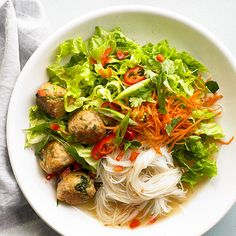 Simmered in a sweet and spicy coconut sauce, ginger-chicken meatballs star in this Chicken Meatball Noodle Bowl. More easy chicken recipes: http://www.bhg.com/recipes/chicken/30-minutes-less/quick-heart-healthy-chicken-recipes/ #myplate