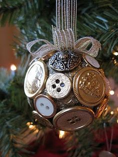 """Metal buttons hot-glued over a spray-painted 2"""" Styrofoam ball."""