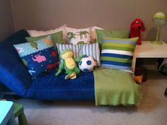 Adjustable kids futon with custom pillows made using Ikea kids duvet cover fabric.