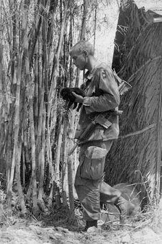 A precious pet in the bush. http://www.pinterest.com/jr88rules/vietnam-war-memories/  #VietnamMemories