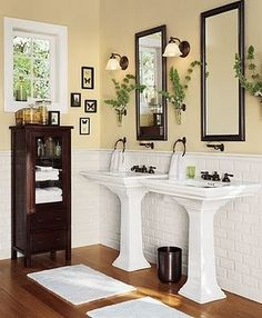 two pedestal sinks with scones on either side- basement.