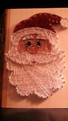Show your holiday spirit with this adorable string art Santa. This piece is roughly 6 x 9 and thick and includes a bracket on the Mais Christmas Art, Christmas Projects, Holiday Crafts, Christmas Decorations, Christmas Baubles, Xmas, Nail String Art, String Crafts, Diy Crafts