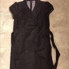 """Black buttoned Bobbie Lee dress Perfect black dress so soft yet controls and contours your figure, it buttons in the front like a trench coat on I'm 5'3"""" & it sirs just below my knees from shoulder to bottom it is 39""""****reduced*** Bobbie Lee Dresses"""