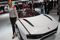 A model stands in front of the Italdesign Giugiaro Parcour at the 2013 Geneva Motor Show.