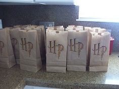 Simple favor idea: Harry Potter logo on plain lunch sacks.--like the treat bags; pin the scar on Harry idea & using a hula hoop as the quiditch goal (throw a ball through it) - online bag shop, bag luggage, bag accessories *ad