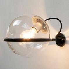 Compact designed from Gino Sarfatti pair of wall lamps for Arteluce, model nr. 238/1. Black metal Lacquered ring where a glass ball is resting, edition Arteluce 1960 Italy.